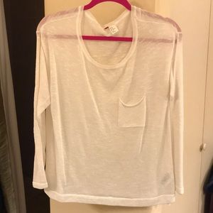 A long sleeve sweater or cover over camisole